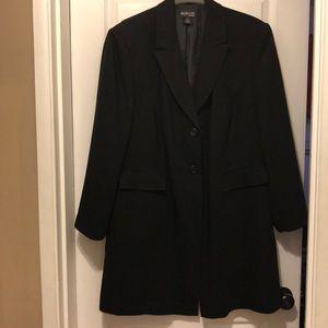 Women's blazer and skirt set.